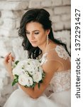 beautiful bride with stylish...   Shutterstock . vector #1372291427