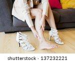 woman rubbing her leg.   Shutterstock . vector #137232221