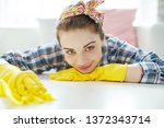woman cleaning the house  | Shutterstock . vector #1372343714