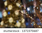 dry twigs entwined with golden... | Shutterstock . vector #1372370687