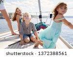 mother and beautiful children... | Shutterstock . vector #1372388561