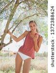 beautiful healthy young woman... | Shutterstock . vector #1372388624