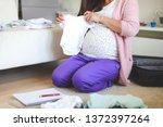 pregnant woman holding bodysuit ... | Shutterstock . vector #1372397264