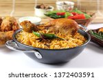 delicious spicy chicken biryani ... | Shutterstock . vector #1372403591