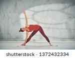 attractive brunette in red... | Shutterstock . vector #1372432334