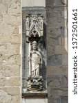 Small photo of Sculpture of Saint James the Apostle, monumental standing figure on the outer side of the flying buttress pier at medieval Gothic Black Church in Brasov city. Transylvania, Romania