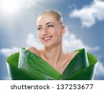 beautiful girl and green leaves | Shutterstock . vector #137253677