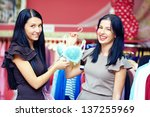 beautiful elegant women in clothes lingerie store - stock photo