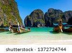 long tail boats on sandy beach  ... | Shutterstock . vector #1372724744