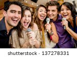 group of friends karaoke... | Shutterstock . vector #137278331