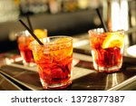 three glasses of iced cocktails ... | Shutterstock . vector #1372877387