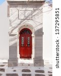 Red Wooden Door Surrounded By...
