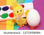 white chicken egg and yellow... | Shutterstock . vector #1372958984