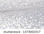 sparkles of silver glitter... | Shutterstock . vector #1373002517