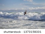 Surf Fisherman In The Waves....