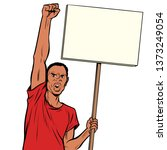 afrikan man protests with a... | Shutterstock . vector #1373249054