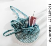 mesh bag with reusable cup on... | Shutterstock . vector #1373254091
