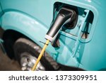 electric vehicle at charging... | Shutterstock . vector #1373309951