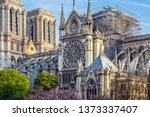 notre dame of paris. on april... | Shutterstock . vector #1373337407