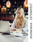 young serious caucasian blonde... | Shutterstock . vector #1373365517
