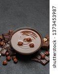 glass bowl of chocolate cream...   Shutterstock . vector #1373453987