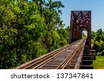 An Old Railroad Trestle With An ...