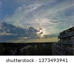 sunbeams through a big cloud at ... | Shutterstock . vector #1373493941