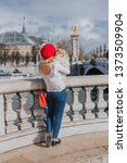 Stock photo french girl with her little fluffy pomeranian dog on the bridge alexander iii in paris 1373509904
