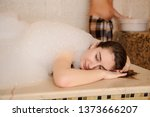 young woman in white foam... | Shutterstock . vector #1373666207