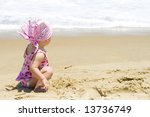 Little baby girl beach portrait - stock photo