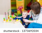 mom and son play in the... | Shutterstock . vector #1373692034