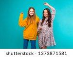 two young girls dancing...   Shutterstock . vector #1373871581