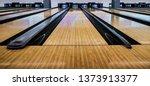 Small photo of Close up of bowling balls, bowling pins bowling balls in a row.