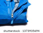 folded blue zipper windbreaker... | Shutterstock . vector #1373935694