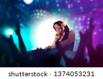 Stock photo young attractive and cool asian japanese dj woman with headphones at night club remixing techno 1374053231
