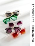 set of stylish sunglasses with... | Shutterstock . vector #1374250721