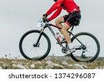 athlete cyclist riding mountain ... | Shutterstock . vector #1374296087