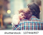 little girl resting on her... | Shutterstock . vector #137446907