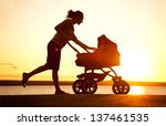 silhouette of  young mother... | Shutterstock . vector #137461535