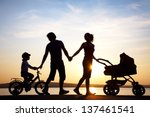 silhouettes of happy parents... | Shutterstock . vector #137461541