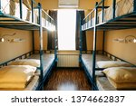 Stock photo backpackers stay in hotel with modern double decker beds inside the dorm room for twelve people 1374662837