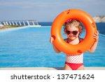 Little Girl In Swimsuit Takes...