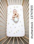 Baby Sucking On Feet In Crib...