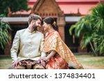 asian bride and caucasian groom ... | Shutterstock . vector #1374834401