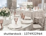 round banquet table served.... | Shutterstock . vector #1374922964