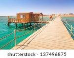 wooden pier with change room... | Shutterstock . vector #137496875