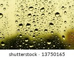 abstract background made of water drops on glass sheet, focus set at the bottom - stock photo