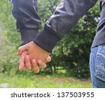 couple holding hands in the... | Shutterstock . vector #137503955