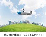 aviator driving propeller plane ... | Shutterstock . vector #1375124444
