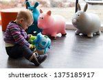 cute fair baby girl sitting on ... | Shutterstock . vector #1375185917